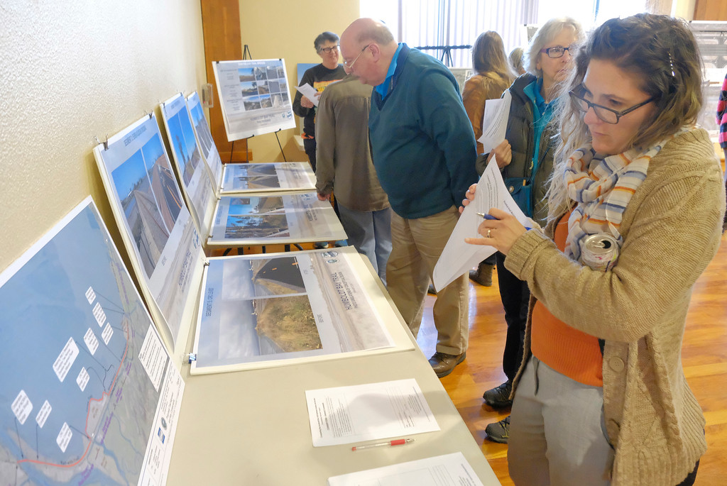 """. Shaun Walker � The Times-Standard  Brittany Gribbin of Eureka looks at an aerial photo at a public meeting to discuss the plan to complete the Humboldt Bay Trail between Eureka and Arcata at the Eureka\'s Wharfinger Building on Tuesday Humboldt County planners invited the community to see the current project design, learn about the strategy for completion, and provide suggestions for improvements. The county is leading the development of the �Humboldt Bay Trail South� project to construct the 4.2-mile link between the two trail projects recently completed by the cities of Arcata and Eureka. The county is \""""committed to designing the project in a way that integrates with adjacent land use, minimizes environmental impacts, meets transportation safety goals, and maintains resilience to flooding hazards and sea level rise,\"""" said county Public Works Deputy-Director Hank Seemann in a press release."""