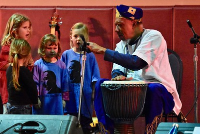 Baba Jamal Koram invites children to the stage to start the first song. José Quezada—For Times-Standard