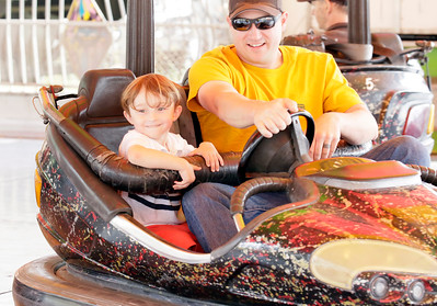 Shaun Walker — The Times-Standard  Oren Baugh, 3, of Eureka and his father Jason enjoy the bumper cars at the Humboldt County Fair in Ferndale on Friday. On Saturday horse and mule racing starts at 2:07 p.m. For more information, go to humboldtcountyfair.org.