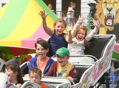 Shaun Walker — The Times-Standard  Children ride the small roller coaster at the Humboldt County Fair in Ferndale on Friday. On Saturday horse and mule racing starts at 2:07 p.m. For more information, go to humboldtcountyfair.org.