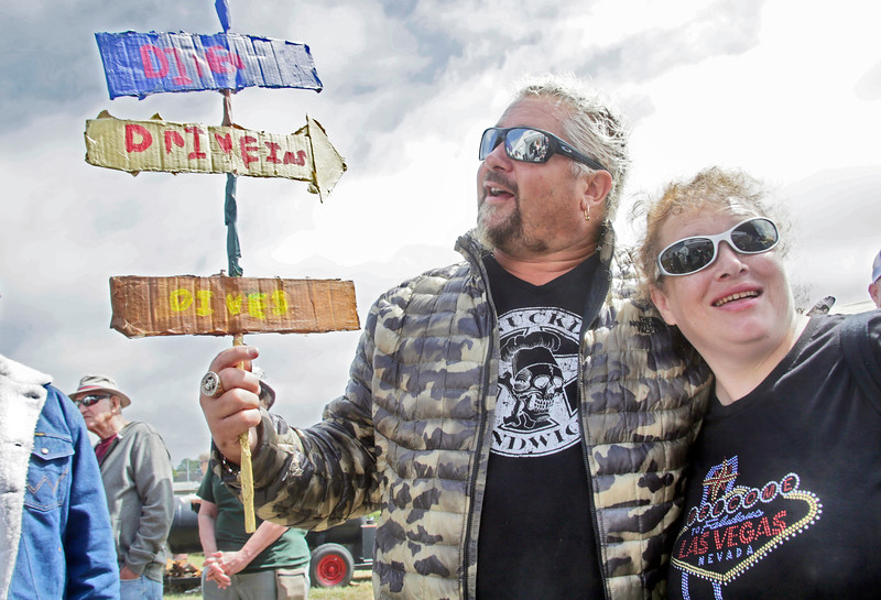 Shaun Walker — The Times-Standard  Food Network star and Ferndale native Guy Fieri hugs fan Tawny Morgann of Eureka as he hold a sign she made and gave to him at the county fair's Surf and Turf BBQ Contest on Thursday.