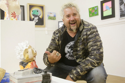 Shaun Walker — The Times-Standard  Food Network star and Ferndale native Guy Fieri smiles at a representation of him that fan Tawny Morgann of Eureka made and entered in the county fair's art competition.