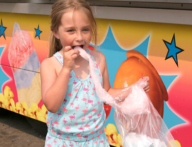 Shaun Walker — The Times-Standard  Autumn Atkins, 5, of Fortuna enjoys cotton candy at the Humboldt County Fair in Ferndale on Thursday. Horse racing resumes at 3:07 p.m. today, and the fair is hosting their Date Night Challenge.