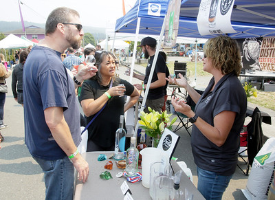 Shaun Walker — The Times-Standard  Humboldt Craft Spirits co-owner Jackie Moore, right, talks with Roger and Vicky Klakken of Eureka after serving them cocktail samples at Humboldt Fervor Fest in Arcata on Saturday. Part of the Creamery Arts Festival, which continues today with circus performances at 1 and 4 p.m., the event celebrated fermented food and drink with makers and samples of sauerkraut, kimchi, kvass, cheese, pickles, hard cider, distilled spirits, beer and wine tastings, and fermented non-alcoholic drinks. For more information, go to creameryfestival.com.