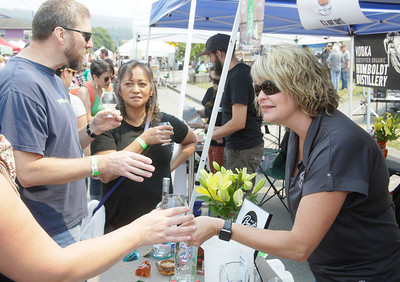 Shaun Walker — The Times-Standard  Humboldt Craft Spirits co-owner Jackie Moore, right, talks with Roger and Vicky Klakken of Eureka and others after serving them cocktail samples at Humboldt Fervor Fest in Arcata on Saturday. Part of the Creamery Arts Festival, which continues today with circus performances at 1 and 4 p.m., the event celebrated fermented food and drink with makers and samples of sauerkraut, kimchi, kvass, cheese, pickles, hard cider, distilled spirits, beer and wine tastings, and fermented non-alcoholic drinks. For more information, go to creameryfestival.com.