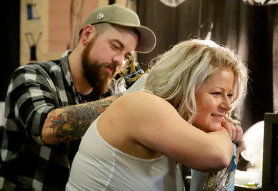 Shaun Walker — The Times-Standard  Mike Arneson of Primate Tatu of Eureka works on Julie Smith of Fortuna.