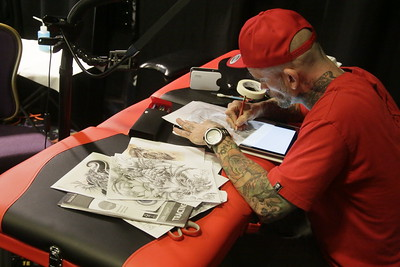 Shaun Walker — The Times-Standard  Mark Matthews, who works in Sacramento and Long Island, sketches designs.