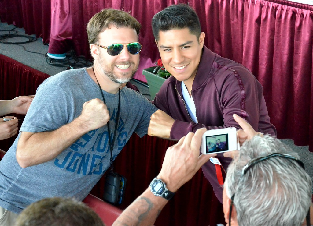 . KYLE MENNIG - ONEIDA DAILY DISPATCH Jessie Vargas poses for a picture with a fan during the 28th annual Induction Weekend at the International Boxing Hall of Fame in Canastota on Friday, June 9, 2017.