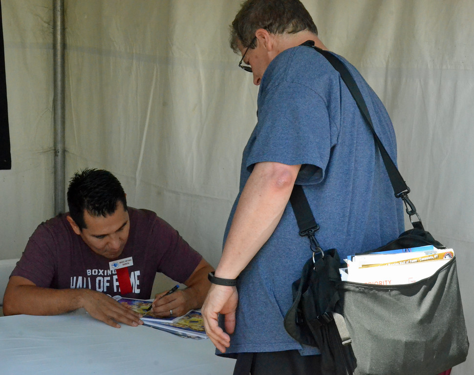. KYLE MENNIG � ONEIDA DAILY DISPATCH Marco Antonio Barrera signs an autograph during the International Boxing Hall of Fame\'s 28th annual Induction Weekend in Canastota on Thursday, June 8, 2017.