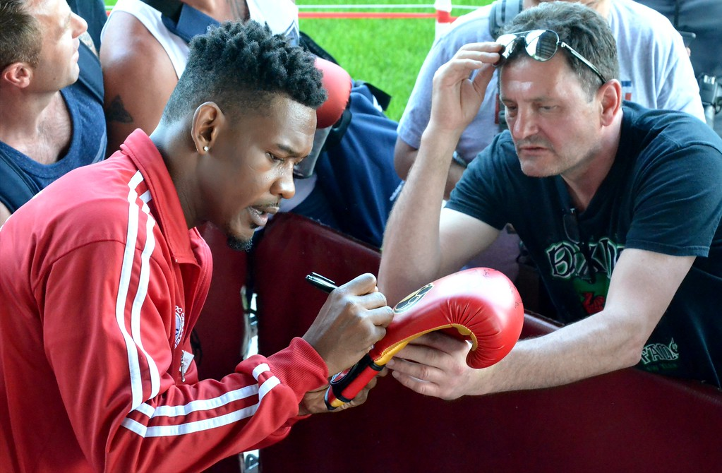 . KYLE MENNIG - ONEIDA DAILY DISPATCH Daniel Jacobs signs an autograph during the 28th annual Induction Weekend at the International Boxing Hall of Fame in Canastota on Friday, June 9, 2017.