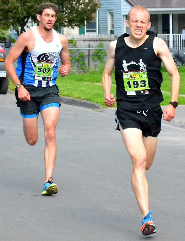. KYLE MENNIG - ONEIDA DAILY DISPATCH Seth Jackson (193) pushes to beat Andrew Foxenberg (507) to the finish line and win the Nate the Great Race 5K during the 28th annual Induction Weekend at the International Boxing Hall of Fame in Canastota on Saturday, June 10, 2017.