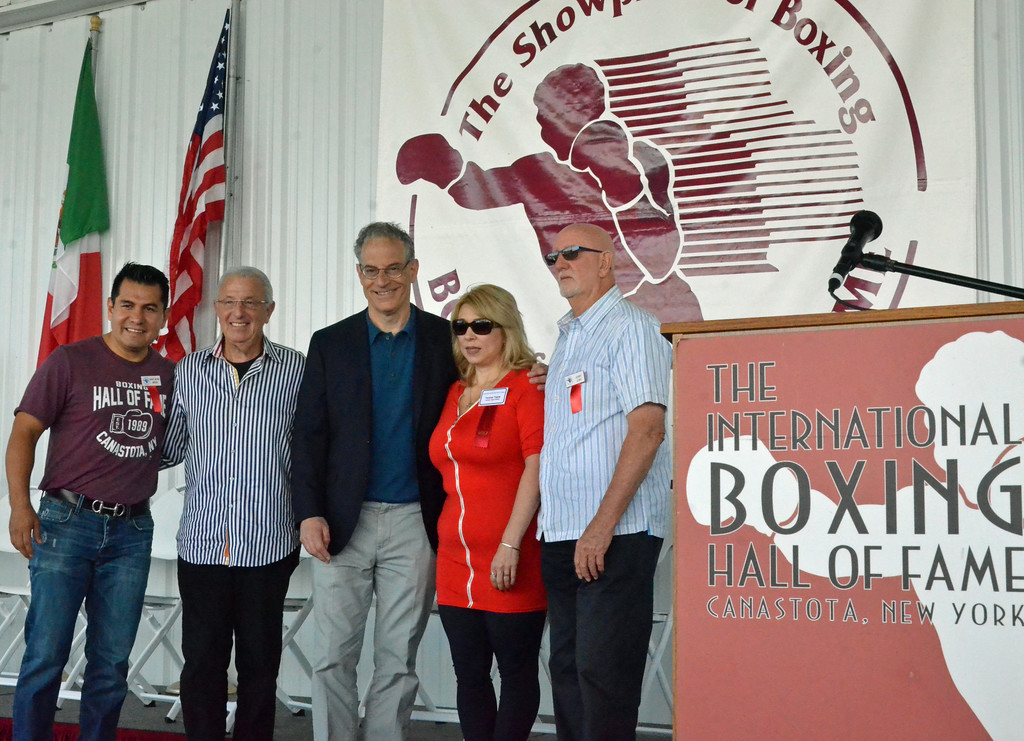 . KYLE MENNIG � ONEIDA DAILY DISPATCH From left, Marco Antonio Barrera, Barry Tompkins, Steve Farhood, Teresa Tapia and Jerry Lewis pose for a picture after ringing the opening bell during the International Boxing Hall of Fame\'s 28th annual Induction Weekend in Canastota on Thursday, June 8, 2017.