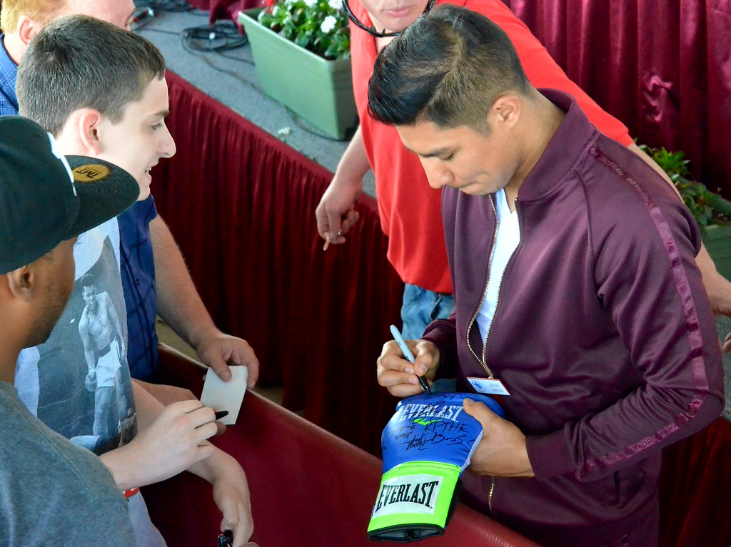 . KYLE MENNIG - ONEIDA DAILY DISPATCH Jessie Vargas signs an autograph during the 28th annual Induction Weekend at the International Boxing Hall of Fame in Canastota on Friday, June 9, 2017.