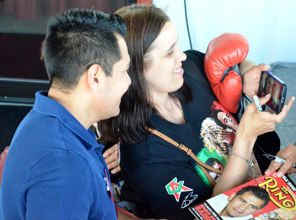 . KYLE MENNIG - ONEIDA DAILY DISPATCH Marco Antonio Barrera takes a selfie with a fan during the 28th annual Induction Weekend at the International Boxing Hall of Fame in Canastota on Friday, June 9, 2017.
