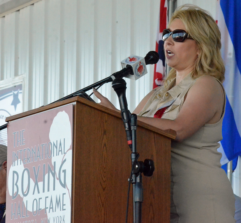 . KYLE MENNIG � ONEIDA DAILY DISPATCH Teresa Tapia gives a speech in honor of her late husband, Class of 2017 inductee Johnny Tapia, at the induction ceremony during the International Boxing Hall of Fame\'s 28th annual Induction Weekend in Canastota on Sunday, June 11, 2017.
