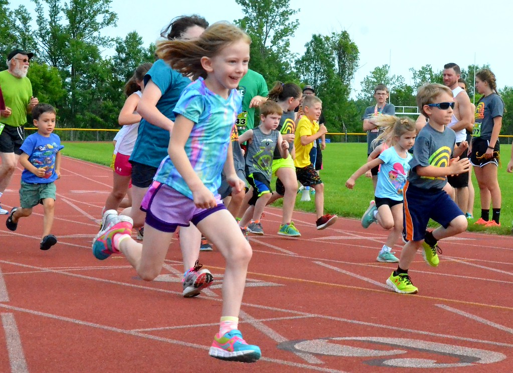 . KYLE MENNIG - ONEIDA DAILY DISPATCH Kids leave the start line of the Nate the Great Race Fun Run during the 28th annual Induction Weekend at the International Boxing Hall of Fame in Canastota on Saturday, June 10, 2017.