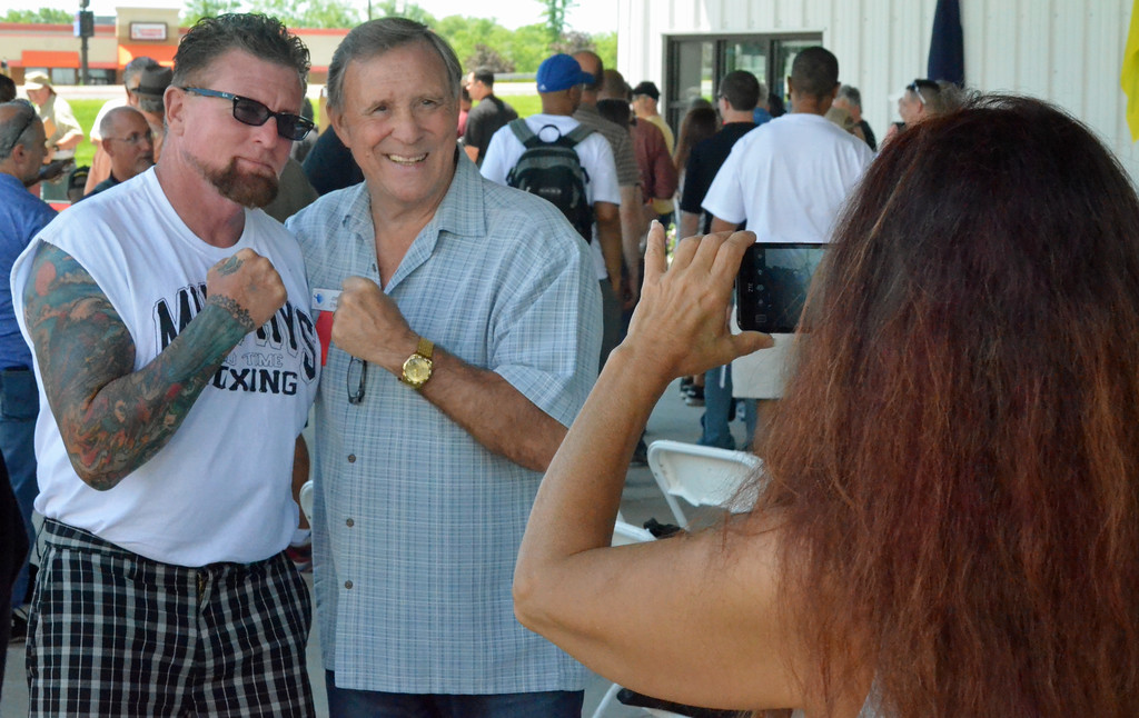 . KYLE MENNIG � ONEIDA DAILY DISPATCH John H. Stracey poses for a picture with a fan during the International Boxing Hall of Fame\'s 28th annual Induction Weekend in Canastota on Thursday, June 8, 2017.