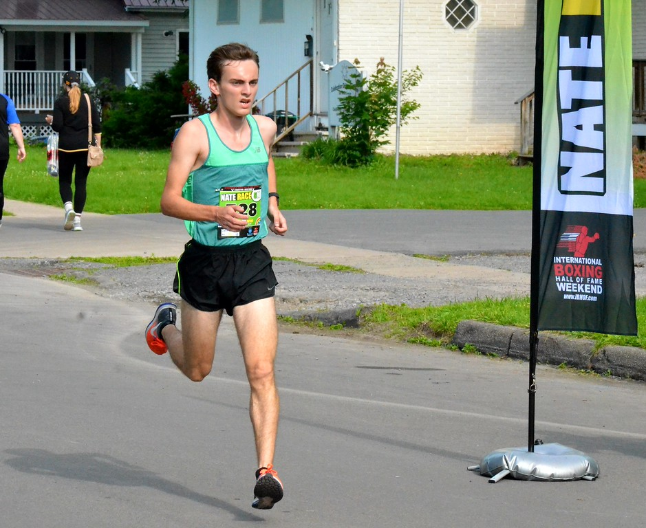 . KYLE MENNIG - ONEIDA DAILY DISPATCH Dakota Corney nears the finish line at the Nate the Great Race 5K during the 28th annual Induction Weekend at the International Boxing Hall of Fame in Canastota on Saturday, June 10, 2017.