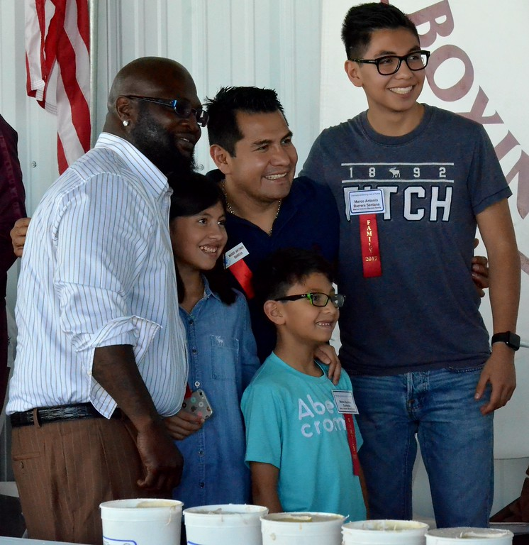 . KYLE MENNIG - ONEIDA DAILY DISPATCH James Toney poses for a picture with Marco Antonio Barrera and his family during the 28th annual Induction Weekend at the International Boxing Hall of Fame in Canastota on Friday, June 9, 2017.