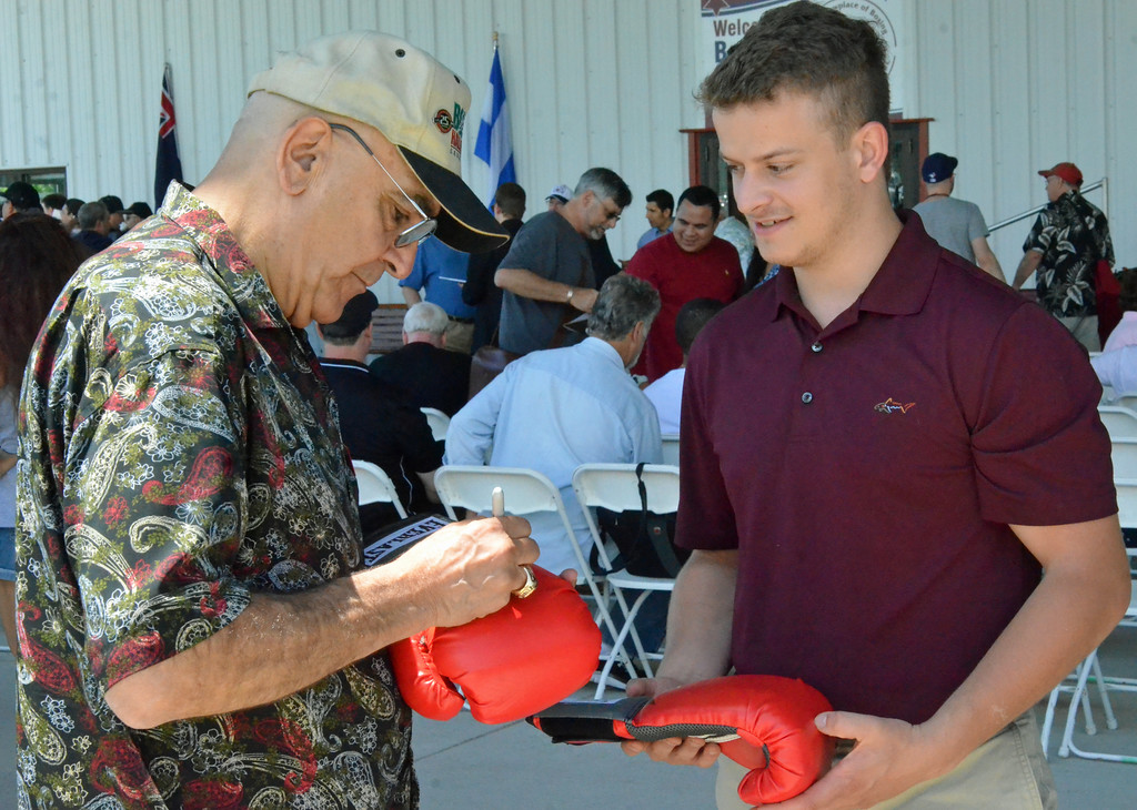 . KYLE MENNIG � ONEIDA DAILY DISPATCH Stanley Christodoulou signs a glove during the International Boxing Hall of Fame\'s 28th annual Induction Weekend in Canastota on Thursday, June 8, 2017.