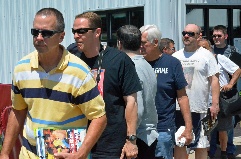 . KYLE MENNIG � ONEIDA DAILY DISPATCH Fans wait in line for autographs during the International Boxing Hall of Fame\'s 28th annual Induction Weekend in Canastota on Thursday, June 8, 2017.