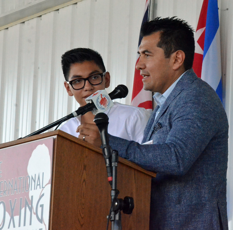 . KYLE MENNIG � ONEIDA DAILY DISPATCH Class of 2017 inductee Marco Antonio Barrera, right, gives his speech as his son Marco Antonio Barrera Santana translates at the induction ceremony during the International Boxing Hall of Fame\'s 28th annual Induction Weekend in Canastota on Sunday, June 11, 2017.