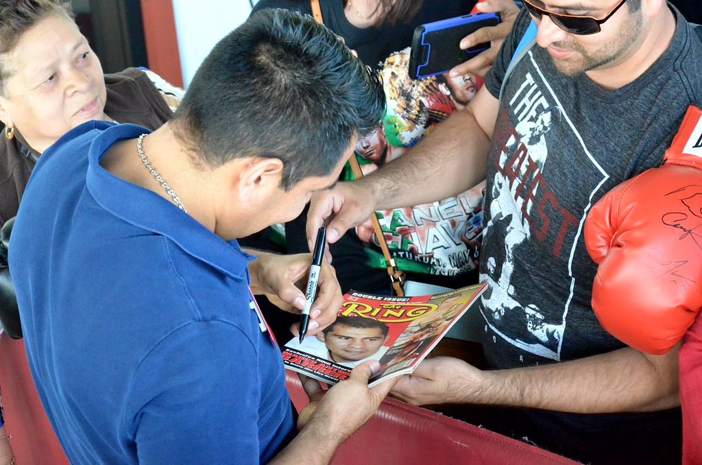 . KYLE MENNIG - ONEIDA DAILY DISPATCH Marco Antonio Barrera signs an autograph during the 28th annual Induction Weekend at the International Boxing Hall of Fame in Canastota on Friday, June 9, 2017.