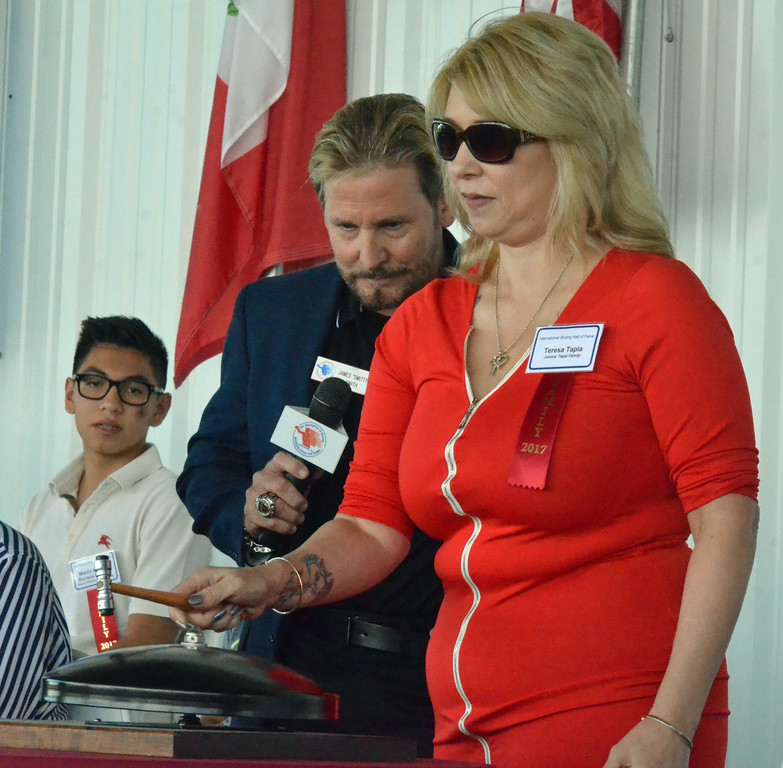 . KYLE MENNIG � ONEIDA DAILY DISPATCH Teresa Tapia, widow of Class of 2017 inductee Johnny Tapia, rings the opening bell during the International Boxing Hall of Fame\'s 28th annual Induction Weekend in Canastota on Thursday, June 8, 2017.