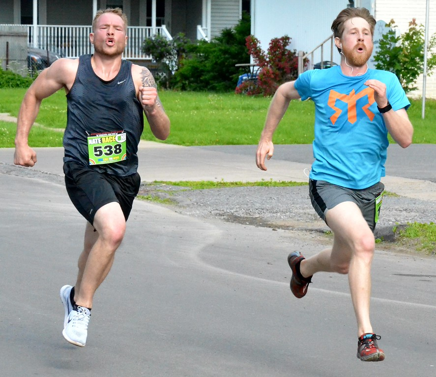 . KYLE MENNIG - ONEIDA DAILY DISPATCH Will Foran (143) and Brandon Cook (538) race to the finish line of the Nate the Great Race 5K during the 28th annual Induction Weekend at the International Boxing Hall of Fame in Canastota on Saturday, June 10, 2017.