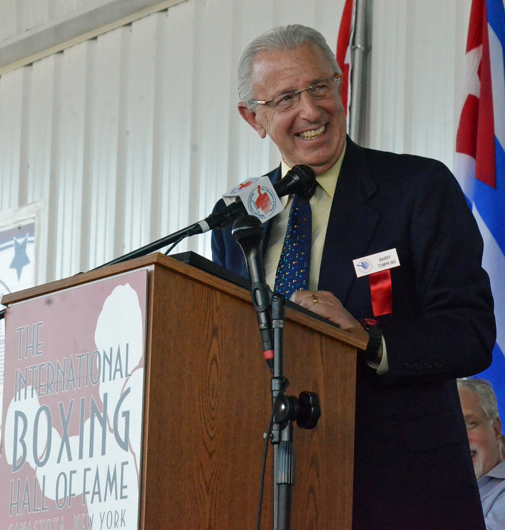 . KYLE MENNIG � ONEIDA DAILY DISPATCH Class of 2017 inductee Barry Tompkins gives his speech at the induction ceremony during the International Boxing Hall of Fame\'s 28th annual Induction Weekend in Canastota on Sunday, June 11, 2017.