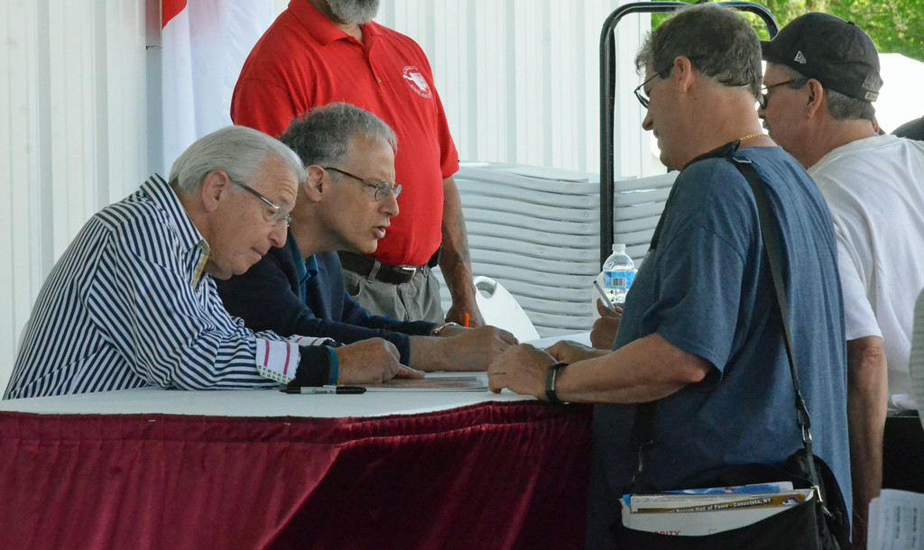 . KYLE MENNIG � ONEIDA DAILY DISPATCH Barry Thompkins and Steve Farhood sign autographs during the International Boxing Hall of Fame\'s 28th annual Induction Weekend in Canastota on Thursday, June 8, 2017.