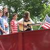 "Richard Payerchin - The Morning Journal <br> Members of the Leslie family perform ""God Bless America"" during the ceremony after the parade of the annual Linwood Park 4th of July Parade, held on July 4, 2016, in Vermilion. The singers were Natalia, Maddie, Harrison and Ava Leslie. Hundreds of people came out for the patriotic celebration of the nation's birthday."