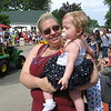 Richard Payerchin - The Morning Journal <br> Faith Birney, 11 months, peers on as her mohter, Lindy Birney of Lorain, holds her up to view the annual Linwood Park 4th of July Parade, held on July 4, 2016, in Vermilion. Hundreds of people came out for the patriotic celebration of the nation's birthday.