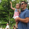 Richard Payerchin - The Morning Journal <br> Palmer Jurecko, 2, waves as her father, J.R. Jurecko, holds her up to view the annual Linwood Park 4th of July Parade, held on July 4, 2016, in Vermilion. Hundreds of people came out for the patriotic celebration of the nation's birthday.