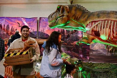 T-Rex Planet staff Lucciano Baocio was a favorite attraction walking around with a moving, shrieking baby T-Rex. José Quezada—For the Times-Standard
