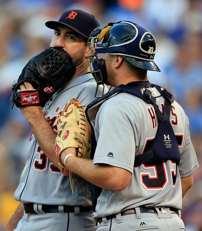 . Detroit Tigers starting pitcher Justin Verlander (35) talks with catcher John Hicks (55) during the third inning of a baseball game against the Kansas City Royals at Kauffman Stadium in Kansas City, Mo., Tuesday, May 30, 2017. (AP Photo/Orlin Wagner)
