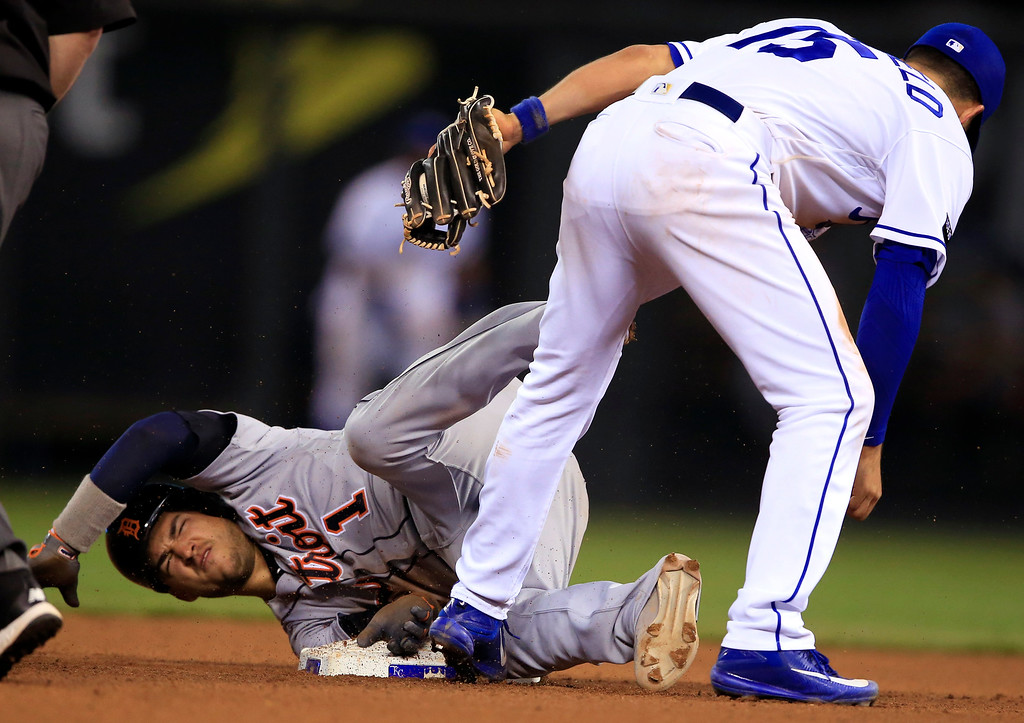 . Detroit Tigers\' Jose Iglesias (1) is tagged out by Kansas City Royals second baseman Whit Merrifield (15) during the eighth inning of a baseball game at Kauffman Stadium in Kansas City, Mo., Tuesday, May 30, 2017. (AP Photo/Orlin Wagner)