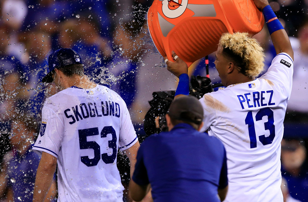 . Kansas City Royals\' Salvador Perez (13) douses starting pitcher Eric Skoglund (53) following a baseball game against the Detroit Tigers at Kauffman Stadium in Kansas City, Mo., Tuesday, May 30, 2017. The Royals defeated the Tigers 1-0. Skoglund won his major league debut. (AP Photo/Orlin Wagner)