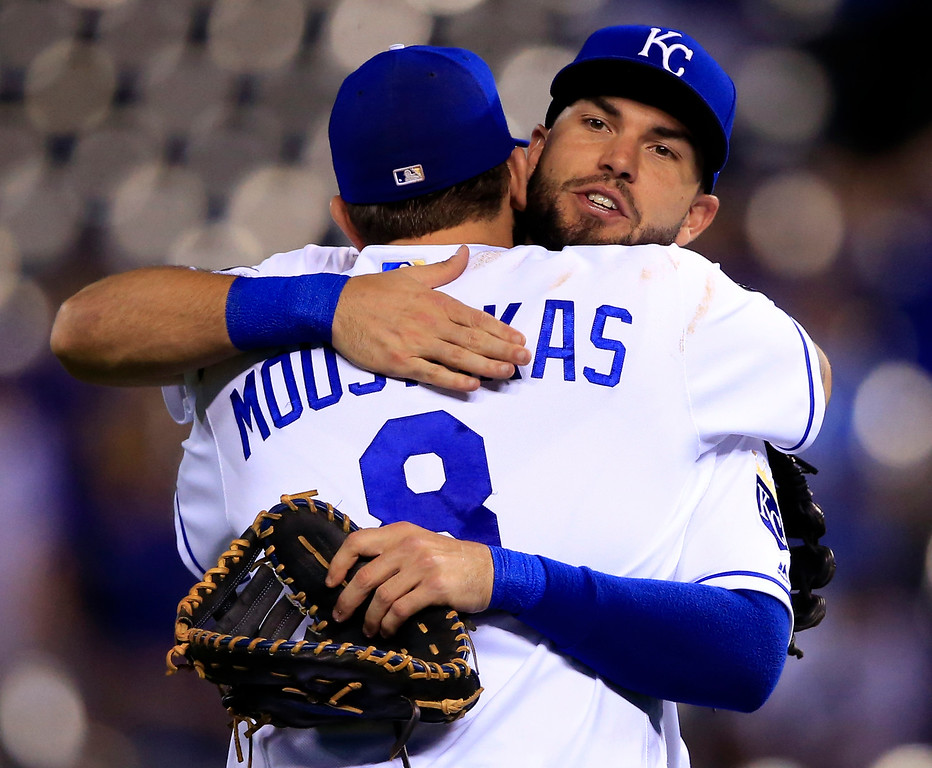 . Kansas City Royals first baseman Eric Hosmer, back, hugs third baseman Mike Moustakas (8) following a baseball game against the Detroit Tigers at Kauffman Stadium in Kansas City, Mo., Tuesday, May 30, 2017. The Royals defeated the Tigers 1-0. (AP Photo/Orlin Wagner)
