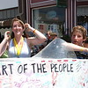"""José Quezada/For the Times-Standard<br /> <br /> Tess Krause, 16, and Alex Crowe, 17, emerge from their kinetic sculpture """"Art of the People"""" after taking the fastest time award. The youth, racing for the Eureka High School EAST Lab, finished the 3-day race in less than eight hours. The third day of the """"Ruby"""" 40th annual Kinetic Grand Championship concluded under sunny skies at the annual finish line at Main and Brown Streets in Ferndale. Thousands of cheering and gaily dressed spectators watched human-powered kinetic art sculptures finish the grueling race after they crossed the Eel River, made cows on the Ferndale bottoms roads moo with delight and finally entered Main Street Ferndale a little haggard, yet in high spirits after enduring mud, sand, brackish bay water for three days."""