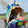 """José Quezada/For the Times-Standard<br /> <br /> Peter Kessler manages the teeth and fins of the """"Uncatchable"""" as it approaches the city limits of Ferndale on Dillon Road. The third day of the """"Ruby"""" 40th annual Kinetic Grand Championship concluded under sunny skies at the annual finish line at Main and Brown Streets in Ferndale. Thousands of cheering and gaily dressed spectators watched human-powered kinetic art sculptures finish the grueling race after they crossed the Eel River, made cows on the Ferndale bottoms roads moo with delight and finally entered Main Street Ferndale a little haggard, yet in high spirits after enduring mud, sand, brackish bay water for three days."""