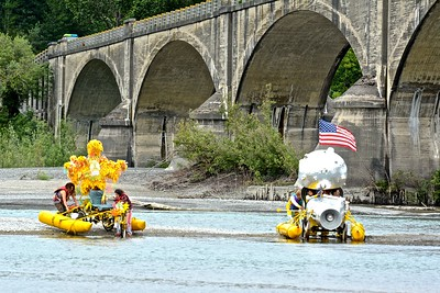 Spring Chickens, piloted by Wende White, and Planet X, piloted by Jenny Weiss and Billy Phinnix refit their kinetic machines on a river bar midway across their navigation across the Eel River at Fernbridge. (José Quezada—For Times-Standard)