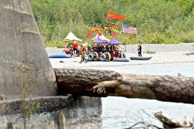 Ken Beidleman and the Samurai Lawyers wait their turn on the east bank of the Eel River, here photographed with a stuck log on a pillar of Fernbridge in the foreground. (José Quezada—For Times-Standard)