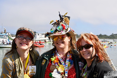 Lovely dockside view with Alice Pitt, center, and race organizer Jenn-O Kime with a friend from the Yellow Bricks Road machine. José Quezada—For Times-Standard
