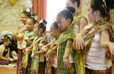 Shaun Walker — The Times-Standard  Humboldt County Lao Dancers dance in handmade costumes to help celebrate Lao New Year at the Humboldt Grange on Saturday. The event also included traditional food, a Buddhist ceremony, and monk blessings.