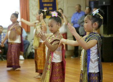 Shaun Walker — The Times-Standard  Annalise Wignot, 6, right, and Ne'Kosha Achane, 6, of Humboldt County Lao Dancers dance in handmade costumes to help celebrate Lao New Year at the Humboldt Grange on Saturday. The event also included traditional food, a Buddhist ceremony, and monk blessings.
