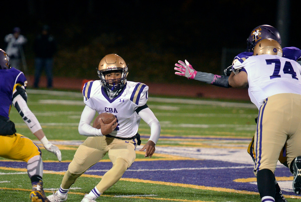 . Shane Marshall - smarshall@digitalfirstmedia.com CBA quarterback Max Jones finds a hole to run through during a Section II Class AA football semifinal vs. Troy at Troy High School on Friday, Oct. 28, 2016.