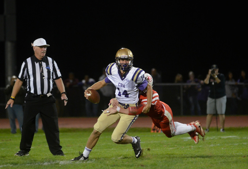 . James Costanzo - jcostanzo@digitalfirstmedia.com CBA quarterback Dom Meola (No. 14) gets sacked against Guilderland at Guilderland High School on Oct. 7, 2016.