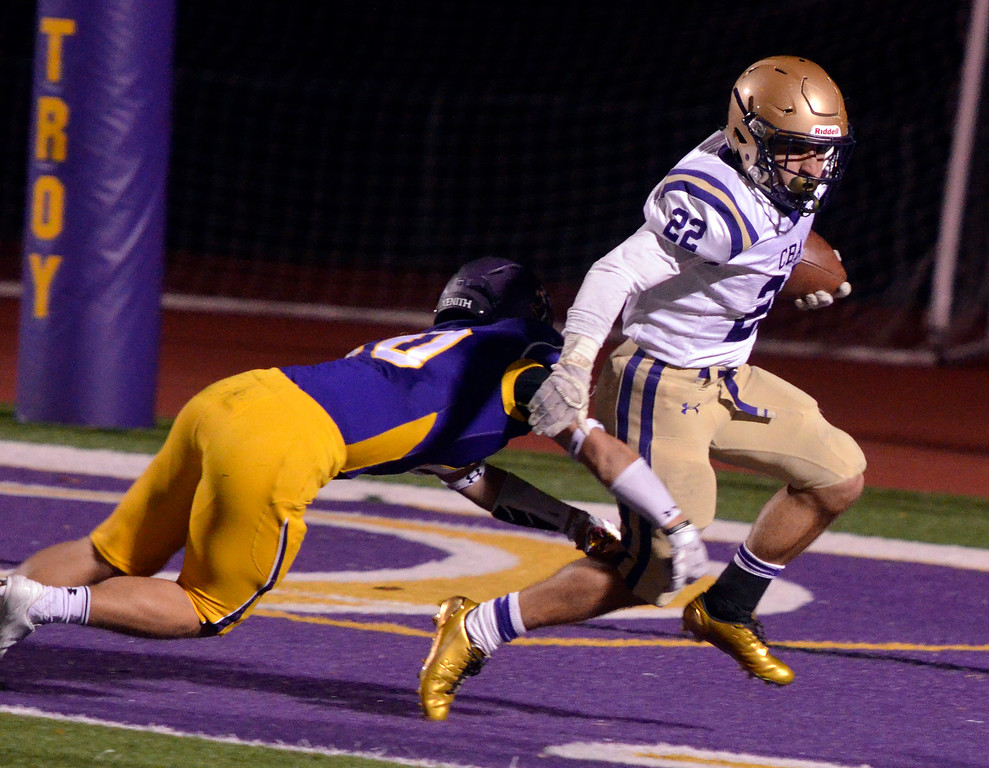 . Shane Marshall - smarshall@digitalfirstmedia.com CBA running back Nick DiNicola (22) breaks a tackle by Troy\'s Matt Ashley (10) during a Section II Class AA football semifinal at Troy High School on Friday, Oct. 28, 2016.