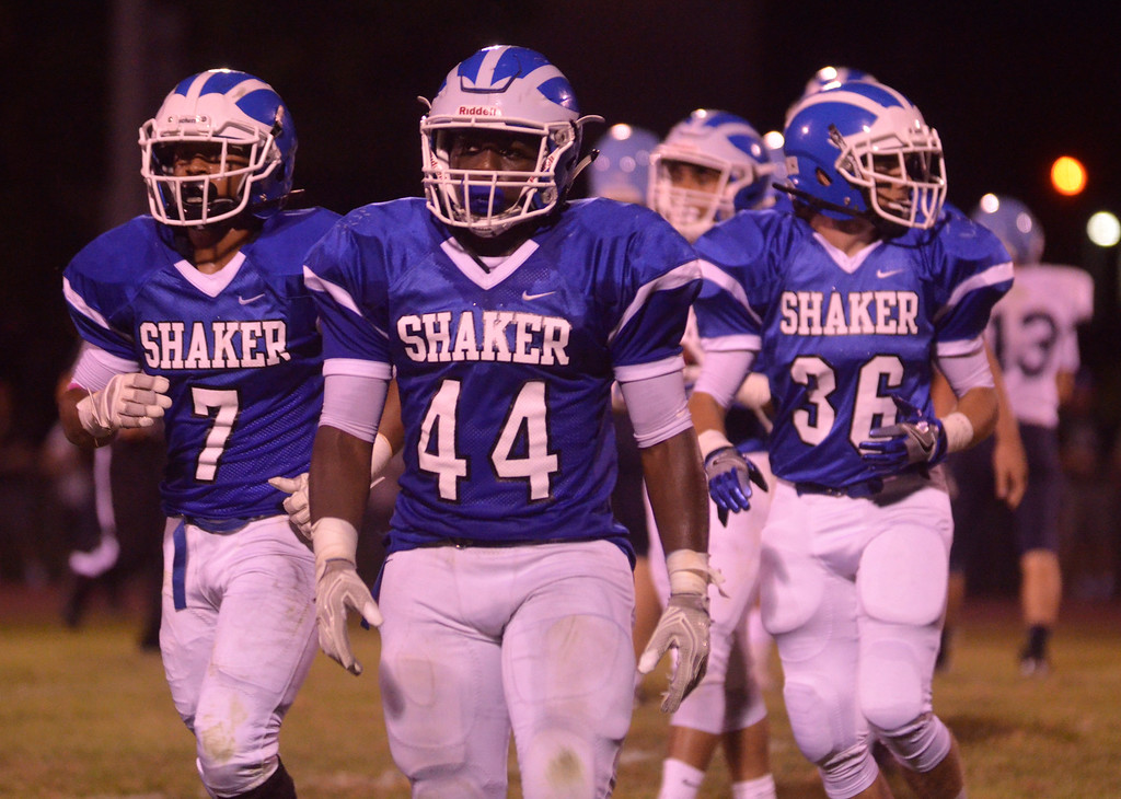 . James Costanzo - jcostanzo@digitalfirstmedia.com Shaker linebacker Kwasi Addo (No. 44) returns to the sideline against Columbia at Shaker High School on Sept. 9, 2016